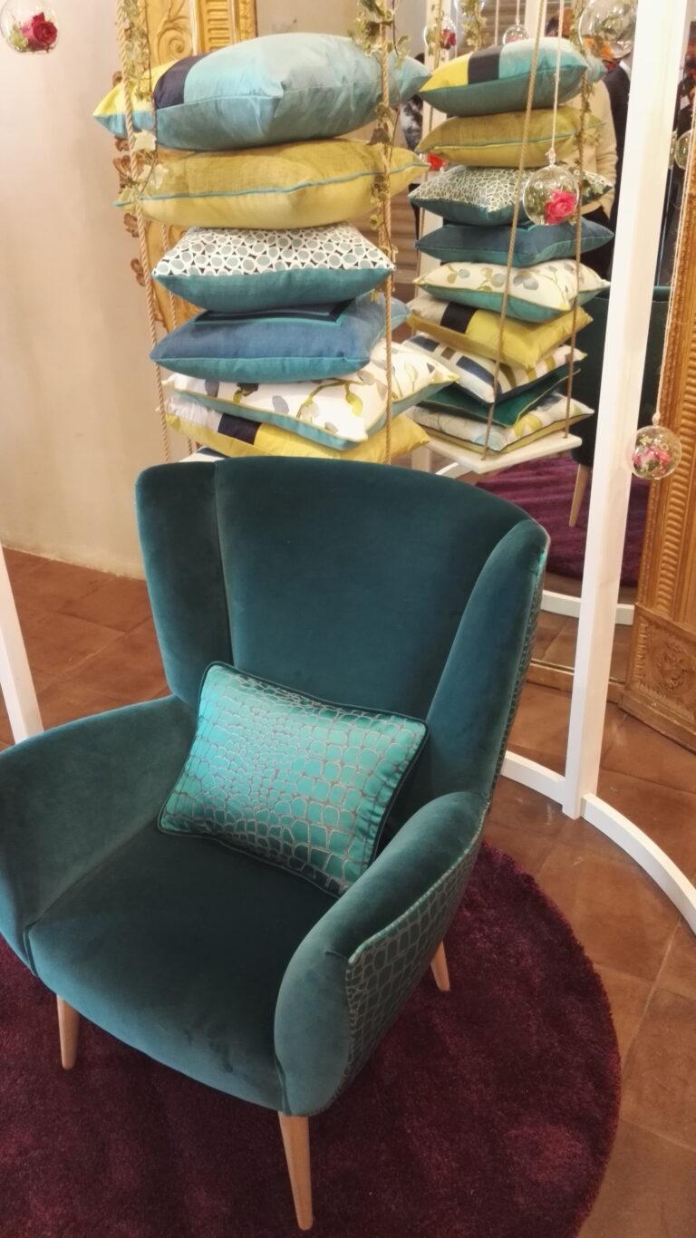Poltrona verde con cuscino